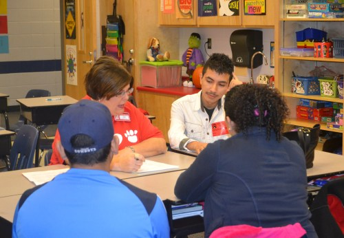 Diego Fraire helps translate a parent teacher conference with Ms. Teresa Smith at Park Creek Elementary. Photo contributed by Paige Watts.