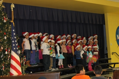 Pre-K performs Christmas carols at the opening of Family Night.