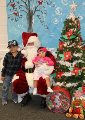 Daniel and Andrea Esparza sit on Santa's lap at Park Creeks Family Night.