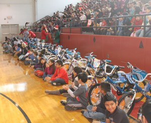 "Academy Sports recently presented thirty bicycles and helmets to students that excelled with ""Cattitude."""