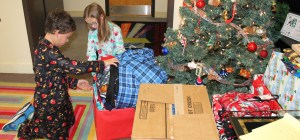 Lily Rehberg and Will Stocks sort through donated pajama that will be given out to Dalton citizens in need.