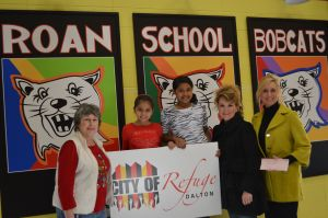 Shown at the check presentation are from left to right, Sally Little, Box Top coordinator for Roan School; fourth grade students Natalia Medina and Berenise Deanda; Assistant Principal Charlie Tripp; and City of Refuge Director Pam Cudd.