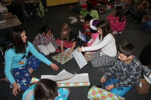 Tiffany Thompson's class wrap their personalized presents.