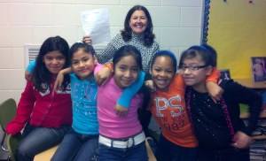 Teresa Hildreth holds up the notification letter congratulating one of her 4th grade teams as the official Dalton City regional winner of the fall 2012 Georgia Stock Market Game Program. The winning team members include Jacqueline Camacho, Katie Santiago, Jaqueline Yanez, Jenniya Jones and Melanie Canchola.
