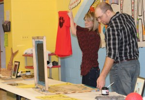 Katie Boliver and Billy Light show Park Creek 5th graders how to print t-shirts.