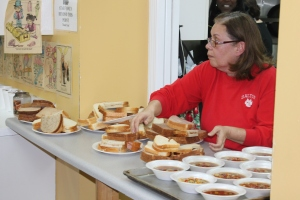 Jennie Lopez serves soup and sandwiches at the City of Refuge Dalton.