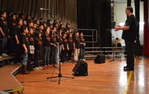 Music teacher Mark Mardis leads the Roan School chorus at the Elementary Chorus Festival Thursday evening.