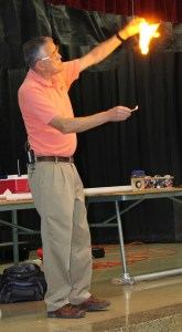 Ben Roy conducts an experiment during Brookwood's recent PTA meeting.