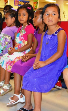 Students wait for their certificates at the Pre-K graduation for the Summer Transition Program.