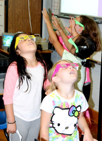 Westwood 2nd grade Challenge students look at the world through 3D glasses.