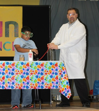 Keith Woodason helps Miguel Ambriz make a cloud in a bottle.