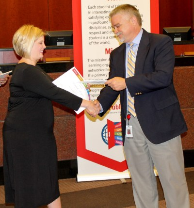 Rebekah Rogers accepts her check from Georgia Power representative Bryan Griffin.