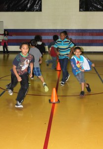 Students in the Running Club run cone drills in the Blue Ridge gym.