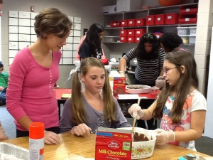 Abbie Lumpkin, Ollie Lambert, and Makayla Kelly work on making brownies.