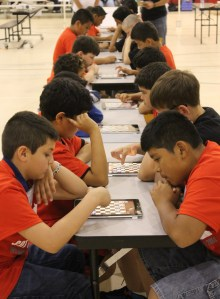 Students face off in the chess tournament at Park Creek.
