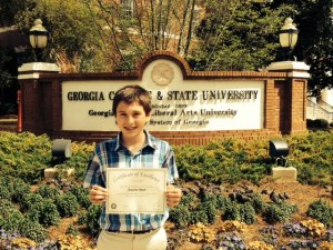 Austin Burt shows off his certificate from the state level of the National Geography Bee.