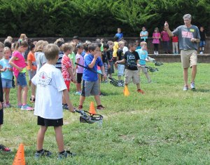 Mike Sanderson instructs Westwood students about lacrosse.