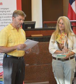Dalton Board of Education Vice Chairman Rick Fromm presents Dalton High German Teacher Ava Wyatt with the 2014-15 Dalton Teacher of the Year award.