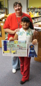 BeLinda Parrish stand with Evelyn Borjas and her first place poster.