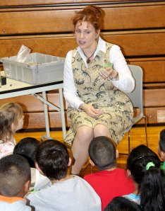 Ms. Frizzle, played by former teacher Shell Underwood, speaks to City Park 3rd graders during Readers to Leaders.