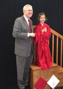 Sarah Butler poses with Superintendent Dr. Jim Hawkins as a part of American Education Week. The photo is designed to reinforce the importance of setting the goal to graduate for both students and parents.