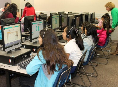 Girls in the City Park Coding Club work lessons on Code.org.
